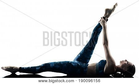 one caucasian woman exercising fitness pilates  excercises in silhouette isolated on white background
