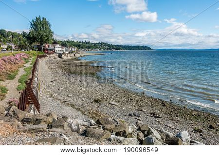A view of the shoreline with homes and water in West Seattle Washington.