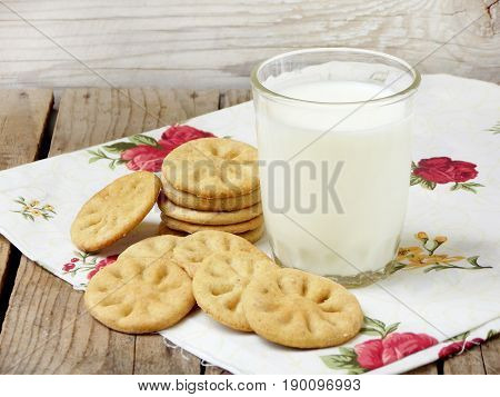 Dietary Prolonged Dry Cookies And Glass Of Milk On Wooden Background