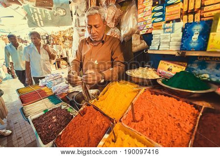 MYSORE, INDIA - FEB 16, 2017: Trader of exotic and colorful incense with sweet smell on city market place on February 16, 2017. With population 900000 Mysore is the cultural capital of Karnataka