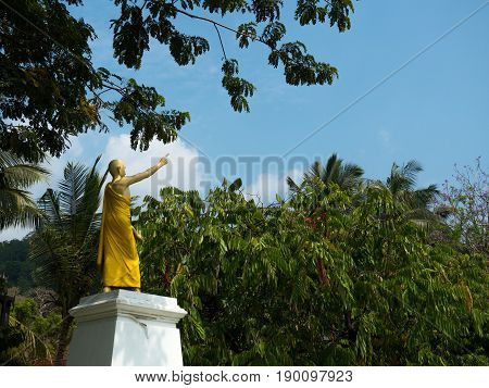 Statue with sky and green trees backround