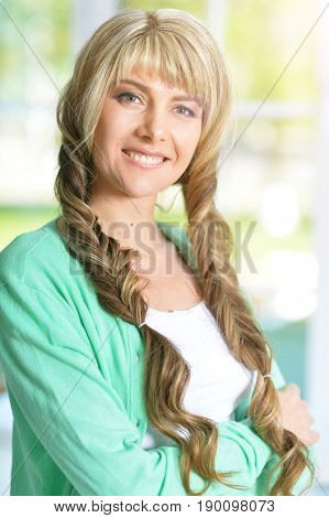 Beautiful young woman with pretty plaited hairstyle