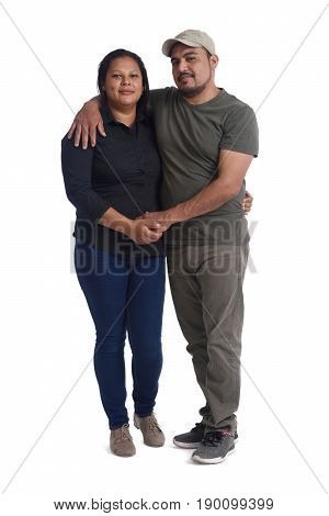a latinamerican couple in love on white background