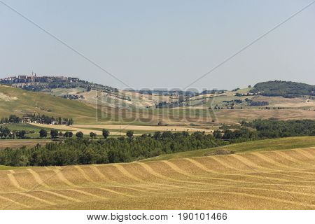 VAL D'ORCIA, ITALY - JUNE 3 2017: Hills surrounding Val D'orcia area in Tuscany region of Italy
