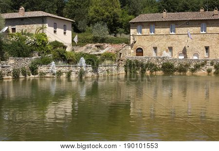 BAGNO VIGNONI, ITALY - JUNE 3 2017: Bagno Vignoni medieval town with its square with hot spring thermal water in Tuscany Italy