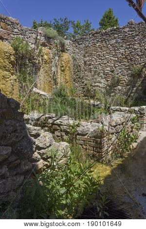BAGNO VIGNONI, ITALY - JUNE 3 2017: Old mill ruins in the hot springs area of Bagno Vignoni in Tuscany Italy