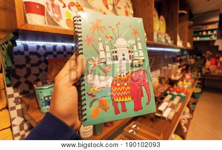 BANGALORE, INDIA - FEB 14, 2017: Notebook with pictures from India - Taj Mahal cow elephant on cover in bookstore on February 14, 2017. With popul. 8.52 million Bangalore is 3rd most populous indian city