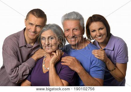 Portrait of happy parents with grown-up children