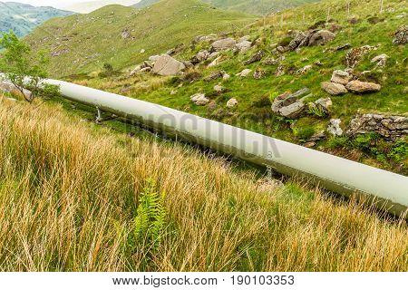Water pipe from lake Llyn Llydaw on Snowdon to Cwm Dyli hydroelectric power station. Snowdonia Wales United Kingdom.