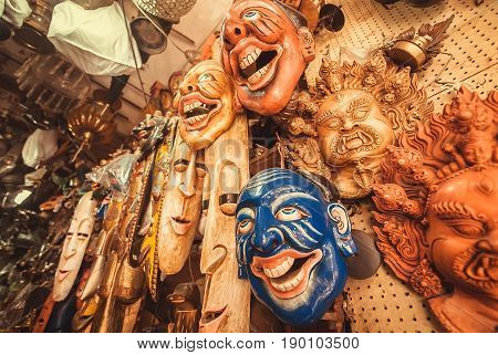 BANGALORE, INDIA - FEB 14, 2017: Old theater and souverir masks in store with vintage art objects and antiques on February 14, 2017. With popul. 8.52 million Bangalore is third most populous indian city