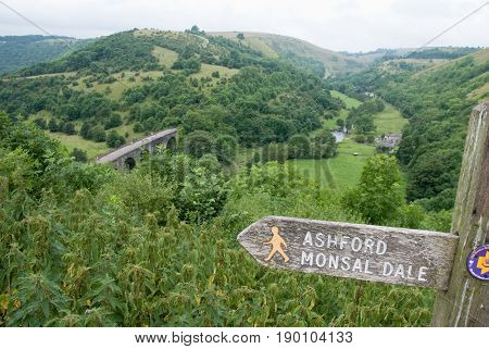 Derbyshire UK - July 20 2014 - Monsal Dale Viaduct and signpost on 20 July at Monsal Dale near Ashford Derbyshire Peak District UK