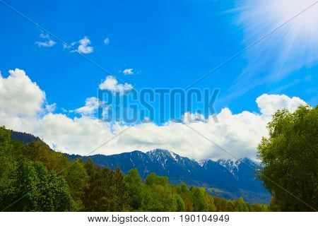 The beautiful view of the austrian alps with blu sky