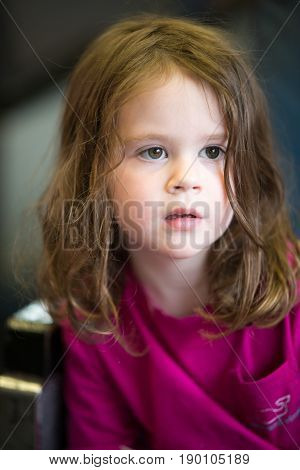 A Close Portrait of Girl Thinking Sitting Down