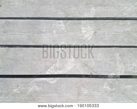 a couple of dirt footprints on wood planks