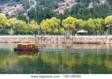 Boat In Yi River And Waterfront On East Hill