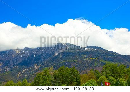 The beautiful view of the Swiss alps with blu sky