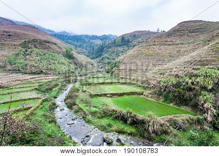 Creek Between Terraced Fields Of Dazhai Village