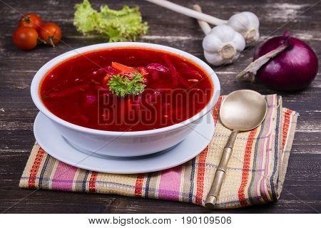 Ukrainian and russian national food - red beet soup borscht . Close up
