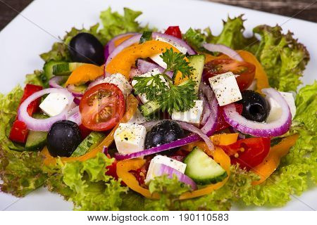 Fresh vegetable greek salad on the table. Close up