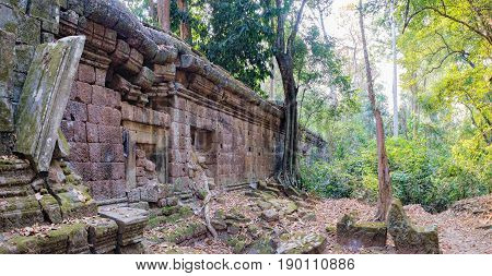 Moss-covered stones of ancient Khmer architecture is located inside the walled enclosure of the Royal Palace of Angkor Thom north of Baphuon, Siem Reap, Cambodia. World Heritage.