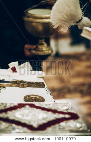 Priest Blessing Golden Wedding Rings On Altar In Church During Wedding Ceremony