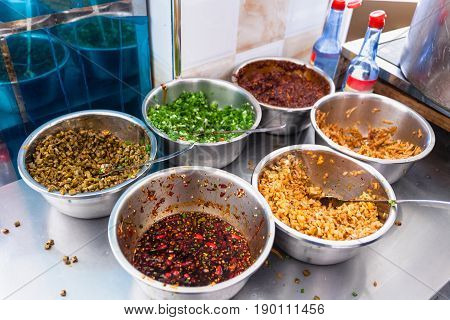 Dishes With Seasonings, Spices And Toppings