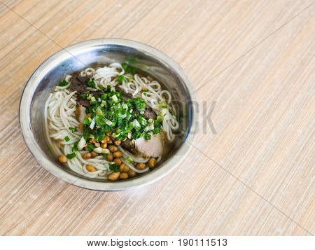 Bowl With Udon Noodles Soup With Pork In Eatery