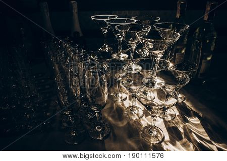 Empty Glasses Of Martini And Champagne On Table At Wedding Reception, Alcohol Bar, Catering In Resta