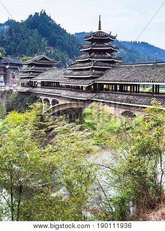 Covered Chengyang Wind And Rain Bridge Over River