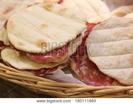 Sandwhiches Stuffed With Sliced Salami And For Sale At The Delic