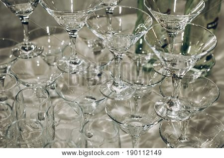 Empty Glasses Of Martini In Pyramid Or Tower On Table At Wedding Reception, Alcohol Bar, Catering In