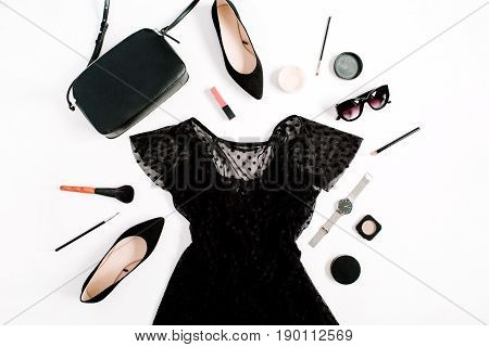 Trendy fashion black styled woman clothes and accessories collection on white background. Flat lay top view. Dress high heels sunglasses purse watches.