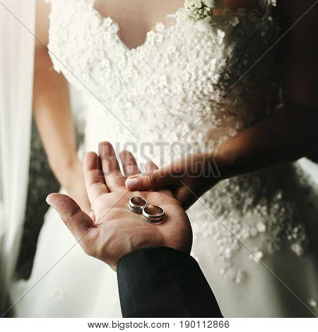 Wedding Couple Holding Luxury Wedding Rings, Groom Showing Bride Wedding Rings On Hand In Morning Ho