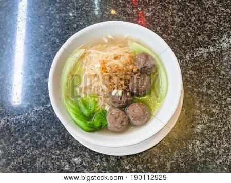 Top View Of Meatballs With Noodle Soup In Bowl