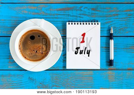 July 1st. Day of the month 1 , calendar on business workplace background with morning coffee cup. Summer concept. Hello July.