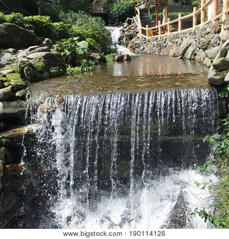 Waterfall With Warm Water From Hot Spring
