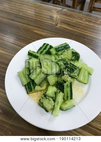 Salad From Fresh Cucumbers In Cheap Eatery