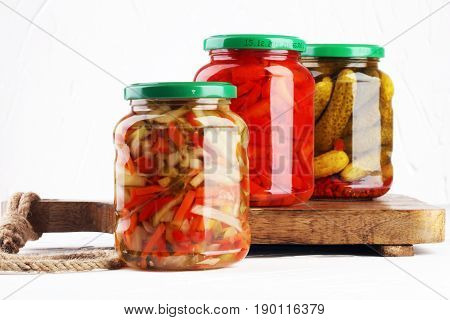 Jar With Variety Of Pickled Vegetables. Carrots, Field Garlic, Cucumber In Glas. Preserved Food