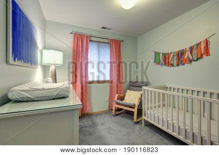 Nursery Room Features Warm Green Walls