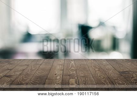 Large office wood table with blurred back. Wood table texture background. Office. Office wood table perspective on blurred office background. Wood table perspective for design. Wood table surface. Rustic wood table perspective on blurred office background