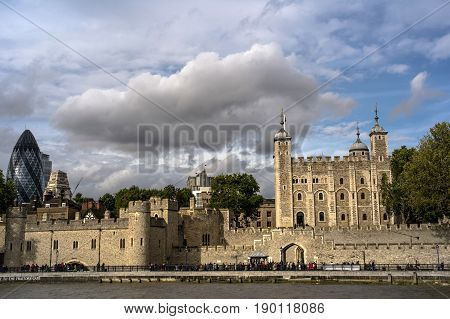 view of the tower of london from river thames