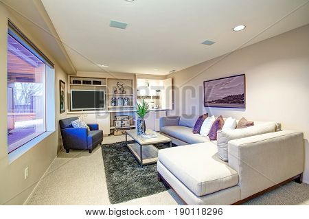 Welcoming Living Room Features Built In Wet Bar