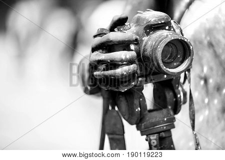 Detail of dirty dslr camera. Equipment mistreat. Black and white.