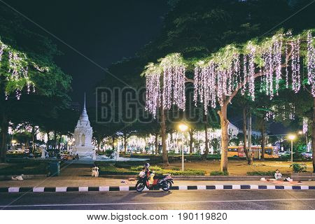 Bangkok, Thailand - December 7, 2015: Street night life in Bangkok. Na Phra That Alley near Sanam Luang is the historic center of Bangkok which decorated with glowing bulbs.