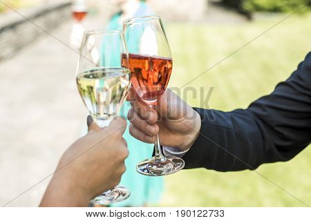 bride and groom holding beautifully wedding glasses with champaign sparkling wine making a toast