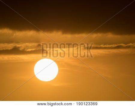 orange sky at sundown and dark clouds above