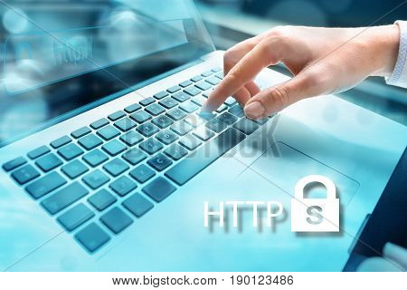 HTTPS - security in the internet concept Closeup of businesswoman hand using computer laptop keyboard with written HHTP and locker icon iwith letter s n the foreground:. Internet security concept. Data security.