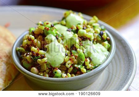 Close-up Healthy Superfood Salad with Rich Protein Made by Quinoa, Avocado, Beans & Grains.