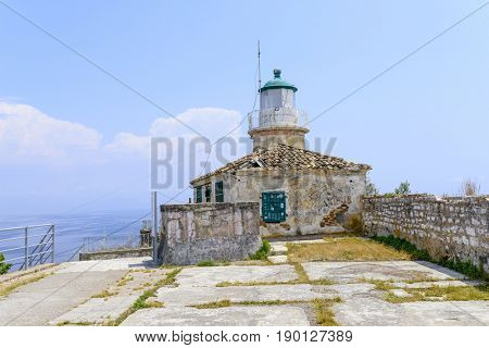 Lighthouse in old Byzantine fortress in Kerkyra, Corfu island in Greece.