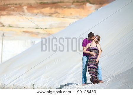lovers on romantic travel honeymoon vacation summer holidays romance. Injoy couple on the beach with white sand, caucasian woman and man embracing and kissing outdoors